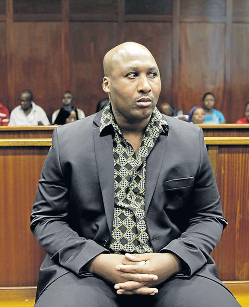 Na foto: O spree killer Joseph Ntshongwana durante seu julgamento em abril de 2013. Créditos: East Coast Radio.
